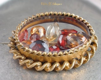 ON SALE  25% OFF Antique Victorian Glass Brooch Filled with Floating Gemstones - Rare Garnet, Topaz, and Citrine