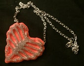 Dead Beat - Ribcage Heart Resin Necklace - Silver Glitter and UV Orange