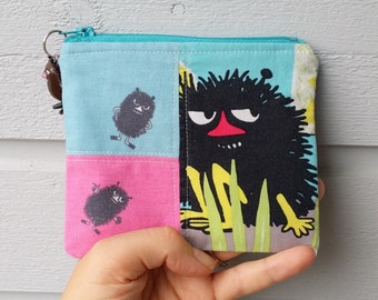 Pretty little zippered pouch coin purse and a charm with Moomin Stinky