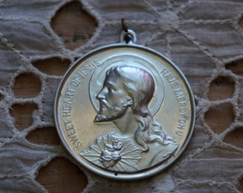 large vintage Vintage religious medal    Silver color metal   Sweet heart of Jesus have mercy on us