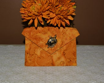 One of a kind corded pockets with brooch