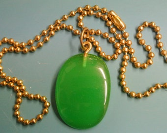 Pendant necklace with genuine tested vintage 1950s halftranslucent grass green tested bakelite plastic bead and brass ball chain