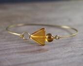 Amber triangle bangle bracelet // golden topaz amber colored Czech glass // modern geometric style // B017
