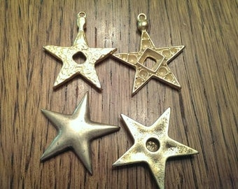 4 Metal Jewelry Stars in Brass Tone