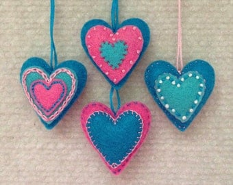 Felt heart ornaments in turquoise, pink and white. Set of 4