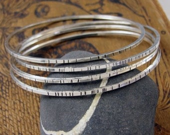 Four skinny bangles - Set of 4 Sterling Silver Bangle Bracelets - silver Bangles - Textured Sterling Bangle set - size Large Medium or Small