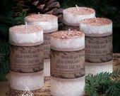 Old England Egg Nog Holiday Pillar Candle . 2x3  . Cream, Sugar, Eggs, Spiced Rum and Bourbon Vanilla Topped with Fresh Nutmeg