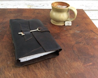 Distressed dark brown leather travel journal with old world torn edge pages by Binding Bee