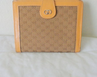Gucci coin purse,wallet in signature GG fabric calf leather,tri fold, small GG print purse vintage 70s Made in Italy