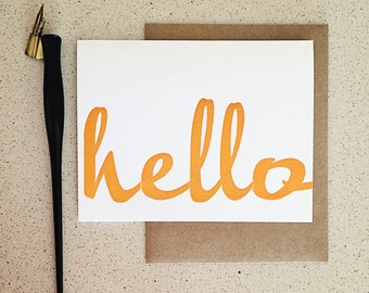 Orange hello wood type script letterpress card