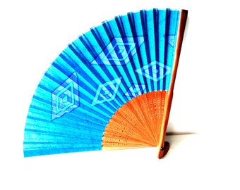 Mod vintage 50s , blue fabric, japanese, hand held fan with a geometric print and wood, lace, filliree pattern handle.