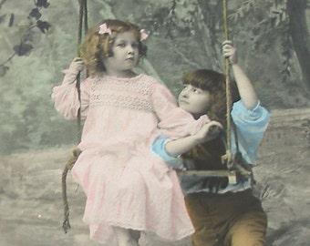1900s French postcard, Edwardian kids on a swing, real photo postcard (RPPC), paper ephemera.