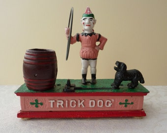 Trick Dog - Reproduction Hubley Savings Bank - Mechanical Money / Coin Box, with clown, dog and barrel