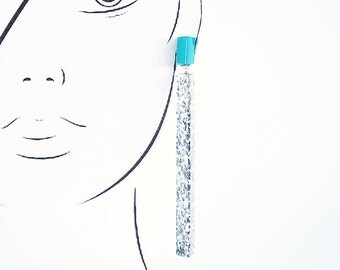Handmade large long chandelier drop facet geometric statement dangle resin earrings in turquoise and silver glitter.