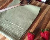 Sage green cotton dishtowel with lace border