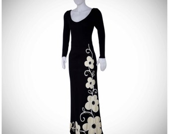 Authentic vintage 1960 black wool maxi dress with applique flowers size medium shipping included within Canada and U.S.A