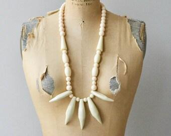 Côte d'Ivoire necklace | vintage 1970s tribal necklace | faux ivory necklace