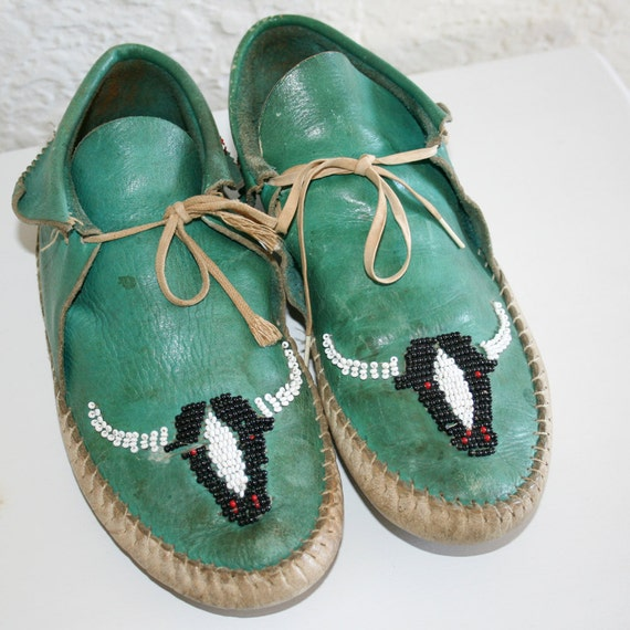 1960s vintage green beaded moccasins with beaded bull design