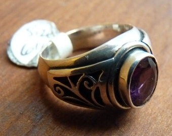 Sterling band with faceted garnet and jali cut detail
