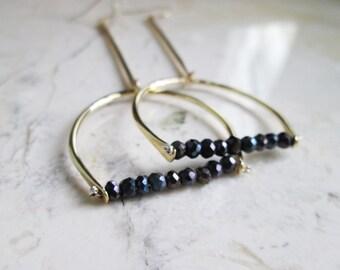 Black Spinel Shoulder Dusters. Long Brass Earrings. Statement Earrings. Golden Brass Dangles. Modern Long Chandeliers. Geometric Earrings.