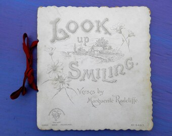 Look up smiling by Marguerite Radcliffe International Arts Publishing early 1900s mini poetry book ornate card bound with red ribbon