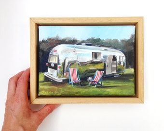framed oil painting of an airstream caravan