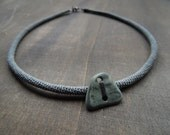 50 % sale: Grey green crochet necklace with a riverstone pebble