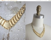 VACATION SALE. golden v necklace