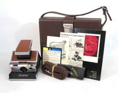 RESERVED for geekykat1 / Vintage Polaroid SX-70 Alpha 1 Folding Land Camera with Case, Strap, Instructions, Flash Bar. Circa 1974.