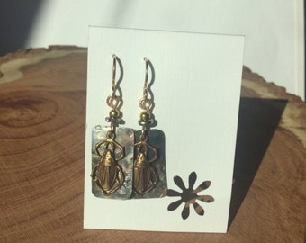 Scarab earrings on Repurposed Vintage tin