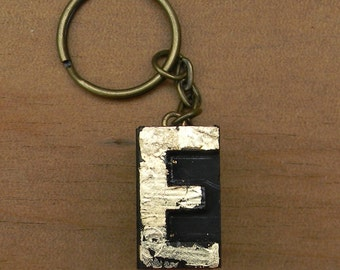 Vintage wooden letterpress keyring, gold leaf finish. Letter E.