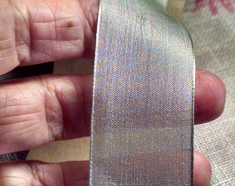 Roll of French silk ribbon. Very pale blue and dreamy.