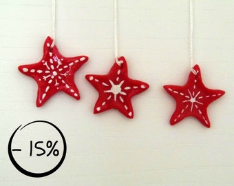Set of 3 decorative stars for Christmas. Red ornaments in corn starch clay painted in white. 15% DISCOUNT