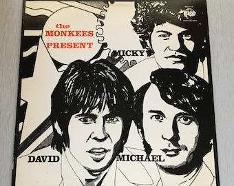 "The Monkees 1986 Rhino records reissue""The Monkees Present"" vinyl record"