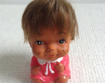 Vintage hard plastic Doll.  Smiling Doll.   So adorable.  4 inches tall.  Made in Korea.