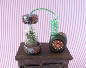 Steampunk hydroponic with power unit and green hose in 1:12 scale