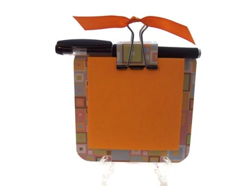 Orange 4x4 chip board with matching binder clip 3M post it note holder with mini black gel pen