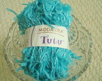 Moda Dea Tutu Yarn in Cabanna Blue, an aqua color, and Raspberry Pink Novelty Yarn, one of each