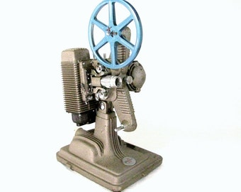 Working 1950s REVERE MODEL 85 8mm PROJECTOR With Case, Cord and Reel
