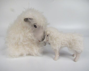 Cotswold Ewe Lying Deep inThought with Standing Lamb