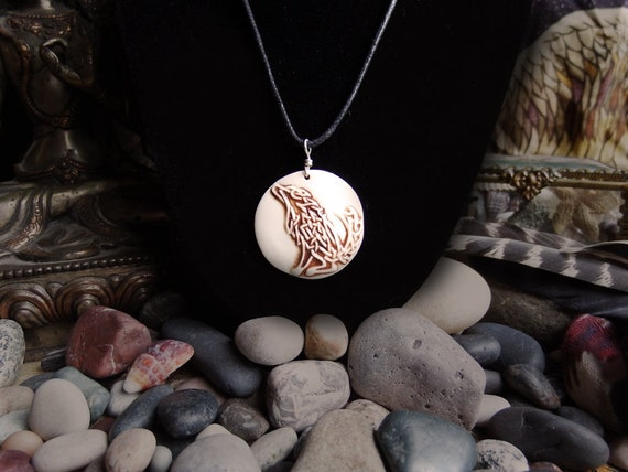 Handmade relief carved porcelain celtic wolf pendant necklace