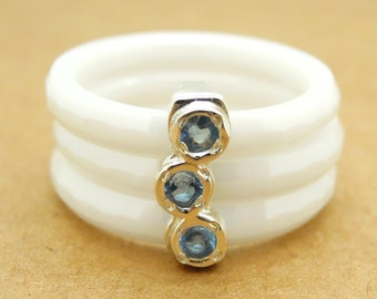 White ceramic stacking ring with blue topaz stones in sterling silver