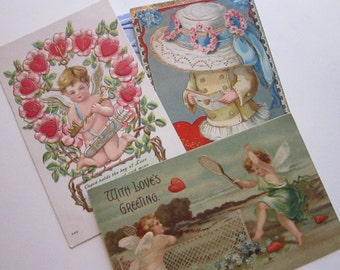 4 vintage VALENTINES DAY postcards - circa early 1900s