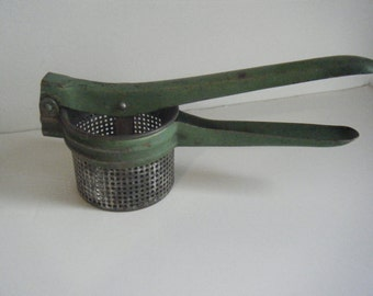 Green vintage 1940s potato ricer masher kitchen gadget