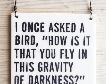 "porcelain wall tile screenprinted text i once asked a bird, ""how is it that you fly in this gravity of darkness?"" she responded, ""love..."
