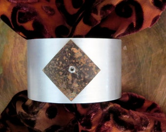 Riveted cuff bracelet in aluminum and copper with organic patina on copper
