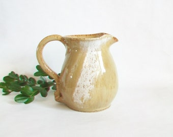 Pitcher - Wheel Thrown in Speckled Stoneware with a Cream and Caramel Glaze