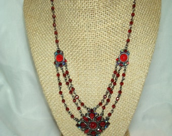 1928 Brand Garnet Colored Jewel Necklace.