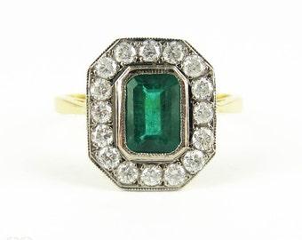 Vintage Emerald & Diamond Cocktail Ring. Deep Green Emerald Cut Emerald with Diamond Halo. 18 Carat Gold, Circa Mid 20th Century.