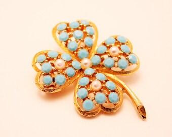 Vintage 4 leaf clover brooch. Turquoise rhinestones